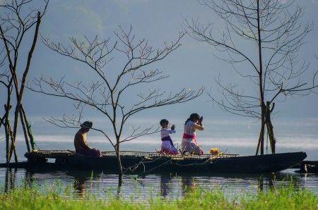 Hendri Suhandi: A daily morning Hinduism prayer in Tamblingan Lake, Bali, Indonesia.