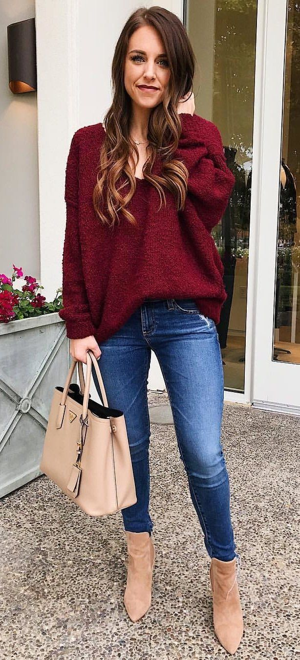 #fall #outfits women's maroon sweatshirt, blue jeans and pair of brown boots outfit. Click To Shop This Look.