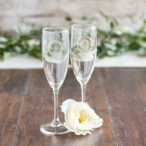 Toast to your new wedded status from personalized champagne flute favors.