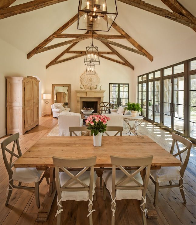 Stunning dining room features vaulted ceiling accented for Vaulted ceiling with exposed trusses