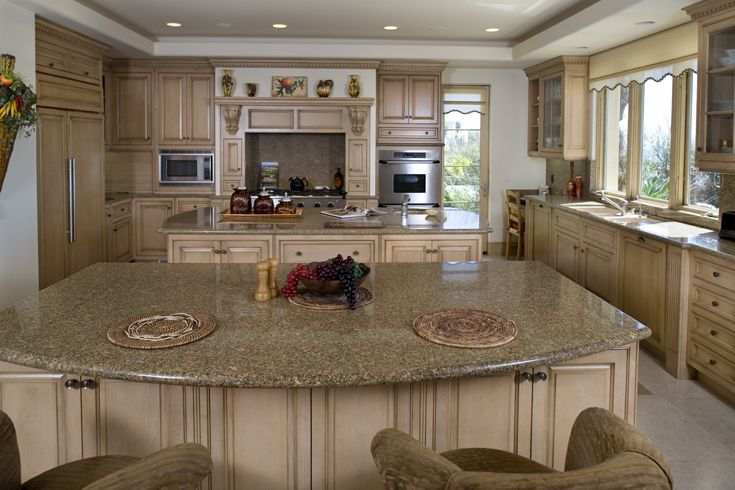 Kitchen: Mediterranean, Tuscan, European Architecture, Island, Crown Molding, Ornamentation, Trim, Raised Panel Cabinet Doors, Glass Panel Cabinet Doors, Cabinet Pulls, Shelf & Corbels, Farm Sink, Oven Hood, Paint & Stained Cabinets, Granite Counter Tops, Recessed Lighting, Wood Windows, Wood Casement Windows, Glass Wood Door, Stone Floor