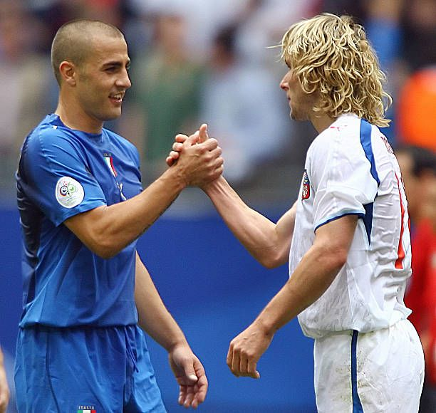 Italian defender Fabio Cannavaro (L) shakes hands with Czech midfielder Pavel Nedved at the end of the World Cup 2006 group E football game Czech Republic vs. Italy, 22 June 2006 at Hamburg stadium. Italy won 1 to 0. Czech Republic is out of the competition.