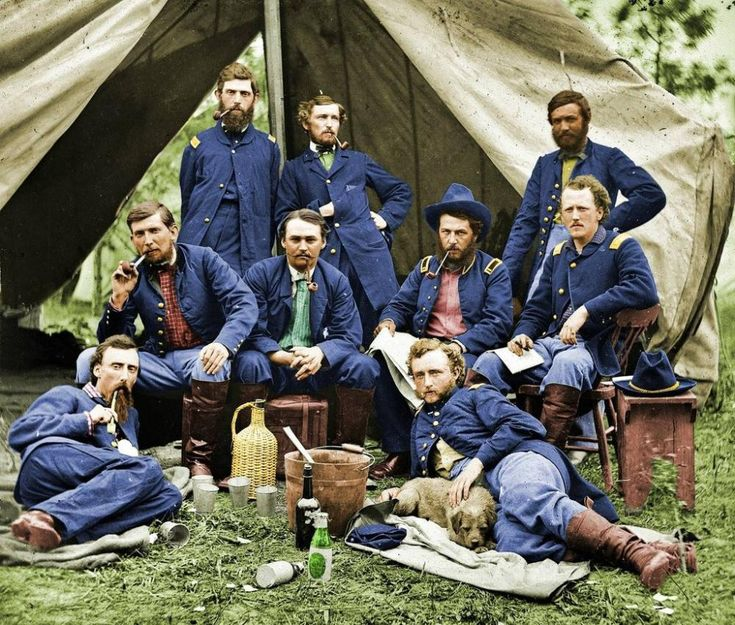 Taken in 1862 during the American Civil War, Lieutenant George Custer sits with his charges from the 2nd U.S. Cavalry in this colorized photograph.