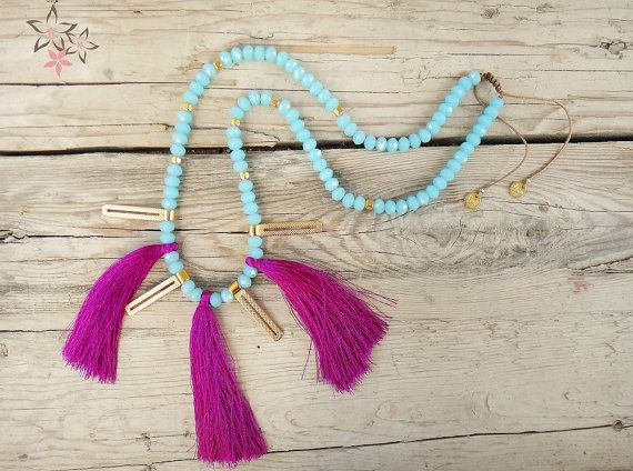 *Jude* Necklace  Handmade long beaded necklace with light blue crystal stones on silk cord adorned with gold plated cast pendants and fuchsia tassels.