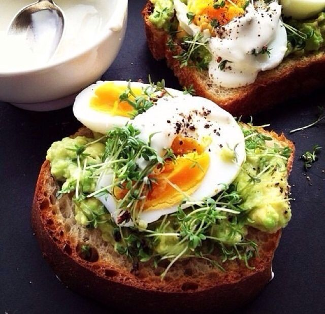 Medium Boiled Egg. Mashed Avocado, Chopped Pea Shoots and Sprouts + Fresh Black Pepper.