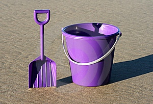 Purple bucket and spade. For kids and grown-up kids.