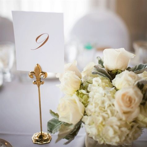 Gold Table Number Holders - these look great for this event.