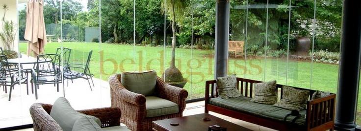 Terraza con cerramiento panoramico, cortina de cristal