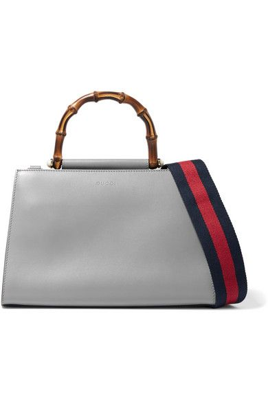 Gucci's Alessandro Michele has a fascination with Greek and Latin mythology - this 'Nymphaea' tote is named after divine spirits who are often depicted singing and dancing. Crafted in the label's Italian atelier from smooth gray and ivory leather, it has a hand-shaped bamboo handle nestled with faux pearls and opens up to two compartments. If you prefer to carry yours over the shoulder or cross-body, attach the red and navy striped canvas strap that's based on the label's heritage webbing.