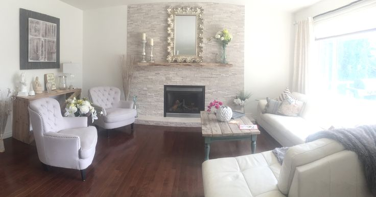 Living room makeover ~ Simply White walls (Benjamin Moore) with white stone fireplace. Lounging in a cloud.