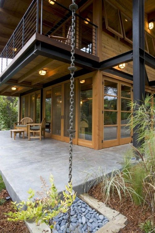 rain chain instead of gutter down spout thing – bet it sounds lovely when it rains  (Sorensen Architects)