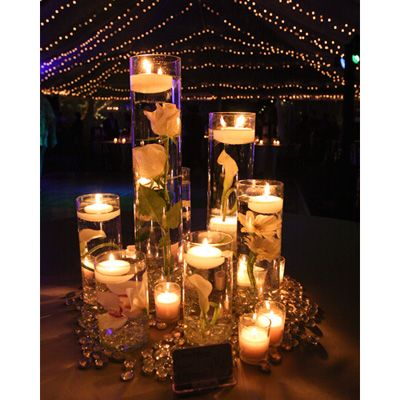 Sunken flowers and floating candles centerpiece