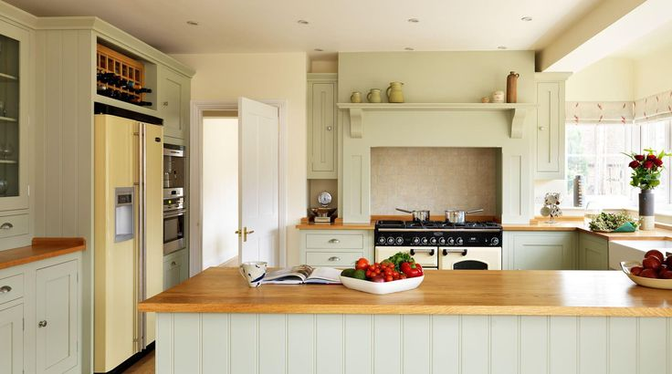 Shaker kitchen with overmantel and range cooker, painted in Farrow & Ball Old White