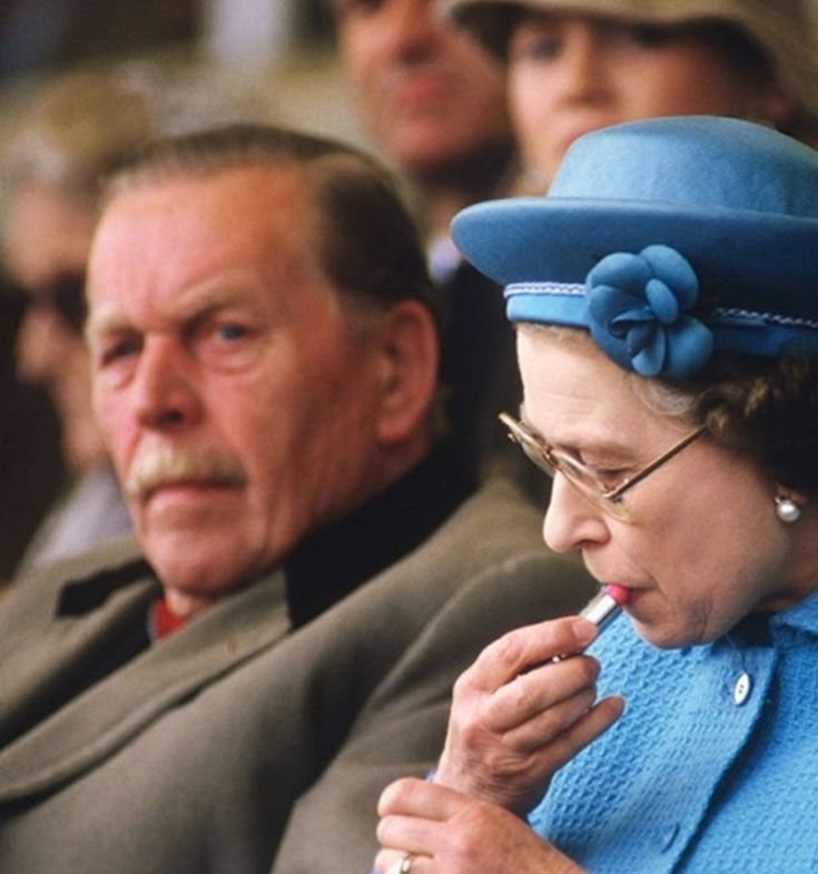 May 11, 1985 Queen Elizabeth II puts on lipstick in the Royal Box at the Windsor Horse Show