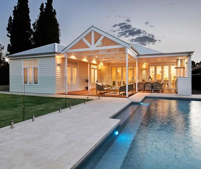 They were competitors on the first ever series of @theblock9 and winners of The Block All Stars, now Phil and Amity have completed their own home. Designed by @amitydry and Peter East and decorated by Amity herself, this family home was built by @scottsalisburyhomes and reflects the couple's love of Hamptons, Queenslander and Edwardian style. Clad in Scyon Linea. Link in bio. #australianarchitecture #architecture #hamptonsstyle #exterior #scyonwalls