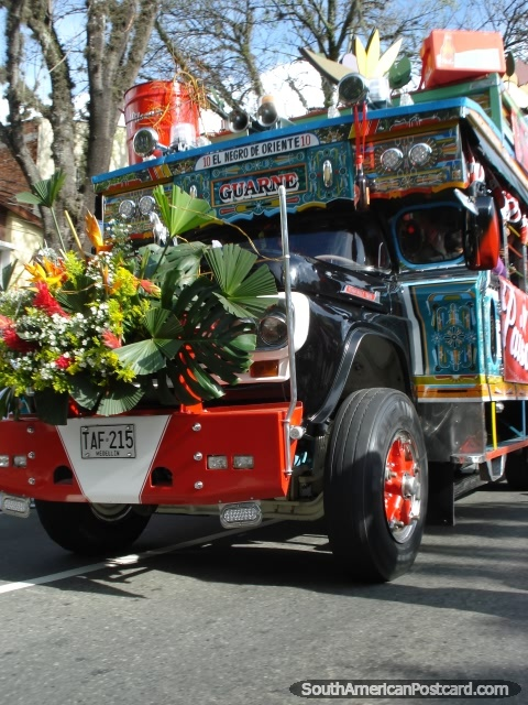 A decorated bus at Feria de las Flores chiva parade, Medellin, Colombia