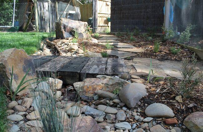 Dry creek bed with bridge in Warranwoood! #drycreek #path #landscapes #australian #native #watermanagement #backyard #phillipjohnsonlandscapes