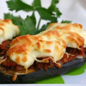 Melitzanes Papoutsakia (Eggplant stuffed with ground lamb with a ...