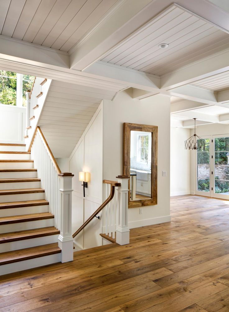 Natural wood with cottage white walls, white railing. Love the floors and the stairs