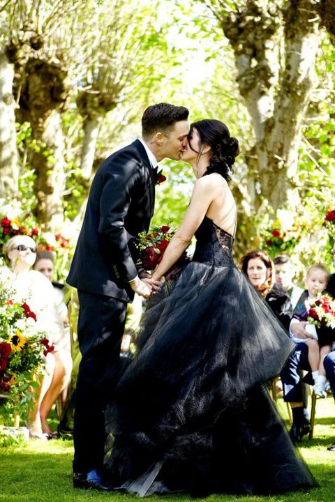 Shenae Grimes wore a black Vera Wang wedding gown with a halter neckline and ball gown skirt to her 2013 wedding to Josh Beech.