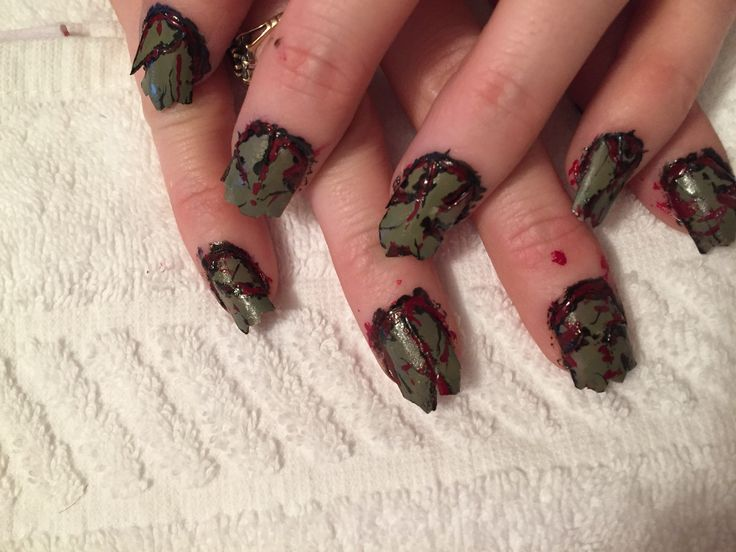 Zombie nails done by me with a little help from my 5 year old in the painting