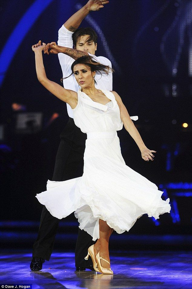 Looking all white! With Gleb Savchenko standing over her, the Watchdog presenter - who narrowly missed out on a place in the final - cut a glamorous figure
