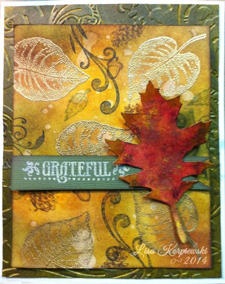 Used lots of different techniques.  Emboss resist, dry embossing, and many distress inks and stains.  The leave was made with Tim Holtz tattered leaves die, glossy paper, and alcohol inks.