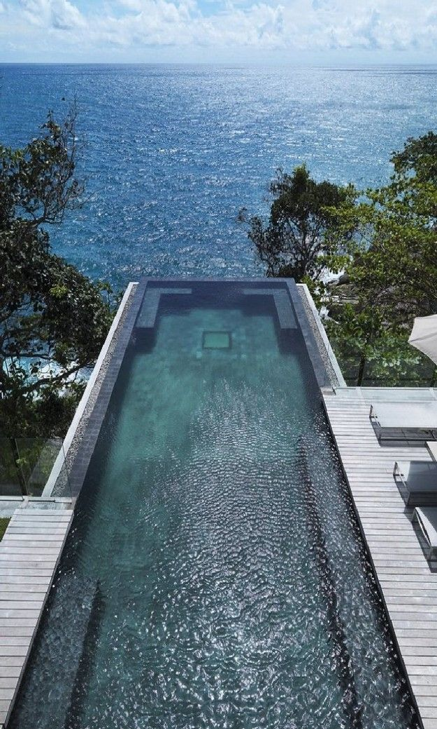 377 best images about pools and decks on pinterest swimming pool designs travertine pavers - Infinity edge swimming pool ...
