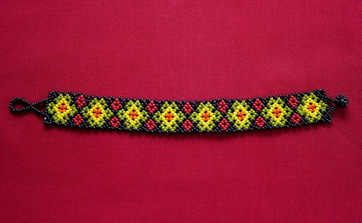 MEXICAN FLOWERS BEADED BRACELET - OLIVE GREEN & YELLOW   ★ Mexican beaded bracelet, with flower path in black, medium olive green, yellow, orange, and dark red. It's simple to wear; it just easily rolls over your hand and is very comfortable. ★ This beaded work is made by Mexican families. ★ You can combine it with various styles!