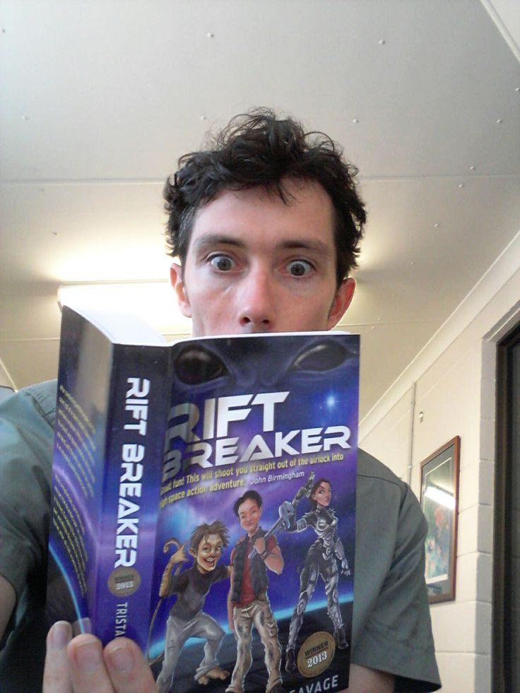 Alex enthralled reading advance copy of Rift Breaker.