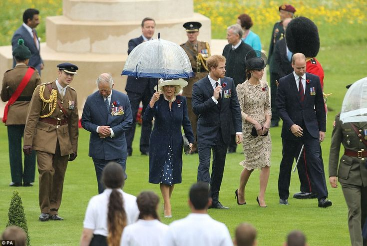 While Camilla was careful to keep herself dry with an umbrella, Prince Charles, Prince Har...