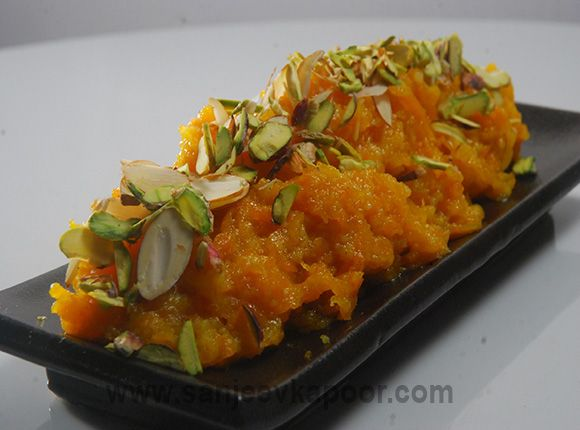 How to make Gajar Halwa - Grated carrots, khoya, sugar, ghee and nuts cooked together to make this delicious Indian sweet dish