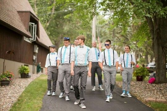 Country Pinterest wedding - groomsman group picture in grey pants, turquoise suspenders, grey converse chucks, bow ties and wayfarer sunnies