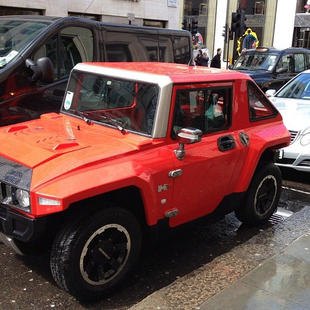 You can really see the size difference in this photo, the one and only MEV HUMMER HX in flat red, London