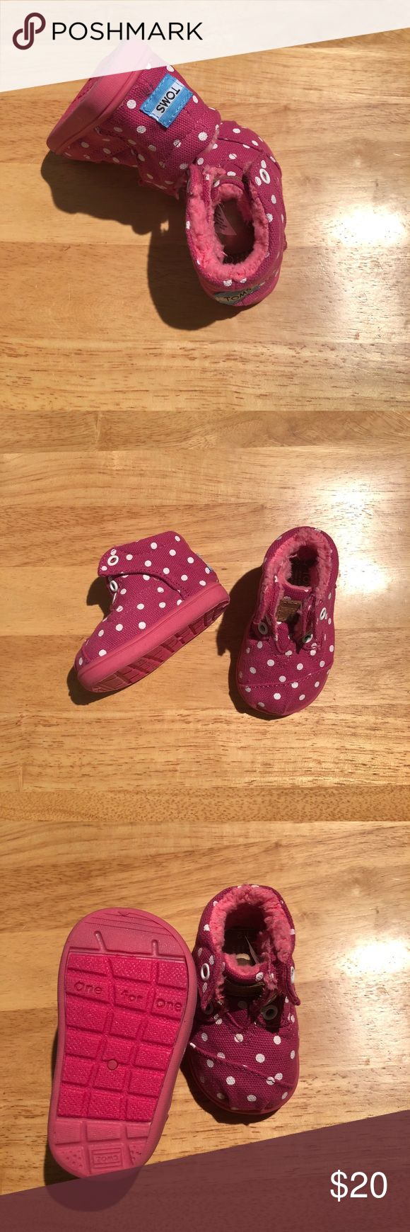 PINK TOMS BOOTS Pink polka dot toms with a fuzzy warm inside!! Size infant 3 NEW WITHOUT TAGS!!! Never been worn! Has Velcro sides for easy access for little baby toes ☺️ Toms Shoes Baby & Walker