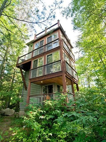 Stay in a treehouse at Ludlow's Island Resort in Minnesota! Details: http://www.midwestliving.com/travel/around-the-region/ultimate-midwest-resorts/page/31/0