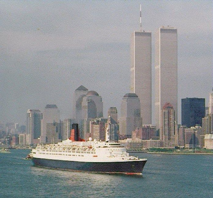 QE 2 in New York harbor with the Twin Towers in the background.