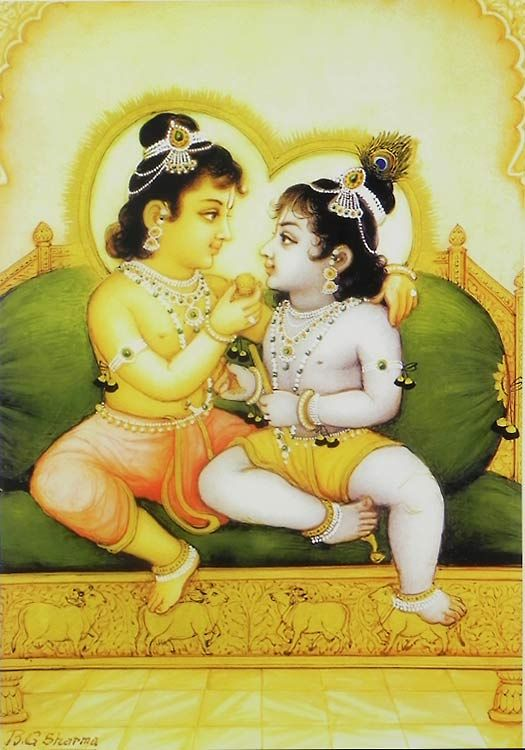 .Balaram ofering laddu to his brother, Lord Krishna.