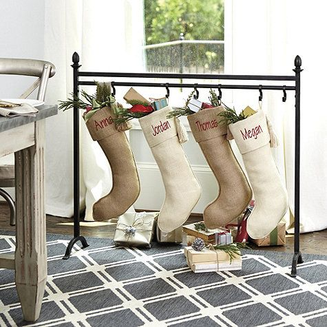 No mantel? No problem. Our Iron Finial Stocking Stand is the perfect solution for families without a fireplace or if you prefer to hang your stockings in a different spot. Removable hooks slide, so you can make room for more stockings. Finial Stocking Stand features: Antique bronze finish