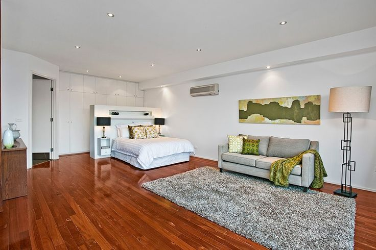 Enjoy the greenery on the artwork and cushions. Modern bedroom, master retreat or parent retreat living.