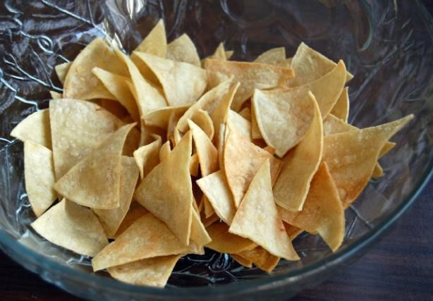 Make your own flour or corn tortilla chips. I would add lime juice and a pinch of salt to mine. :-)