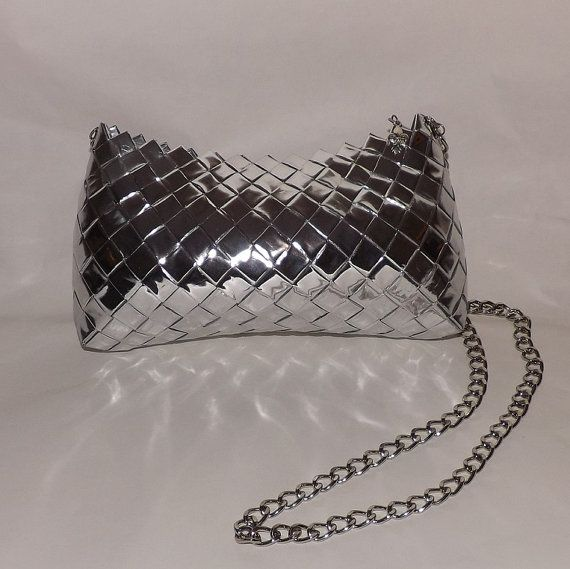 This fun and flirty purse adds just the right amount of bling to any outfit. The purse is made out of recycled papers, such as candy wrappers and