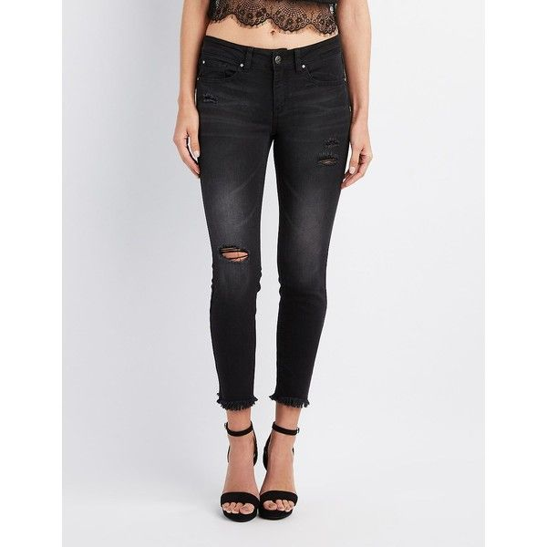 Charlotte Russe Frayed Hem Destroyed Skinny Jeans ($20) ❤ liked on Polyvore featuring jeans, black, skinny jeans, low rise skinny jeans, frayed hem skinny jeans, low rise jeans and ripped jeans