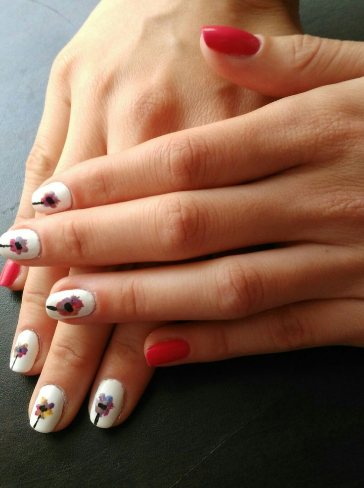 Perfect nails for summer. Colorful flowers and pink nail polish. I love it!