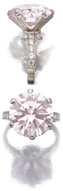 Fancy light pink diamond ring. The fancy light pink brilliant-cut diamond weighing 11.11 carats, the shoulders decorated with near-colourless brilliant-cut stones, mounted in platinum, size 48½. Via Sotheby's.
