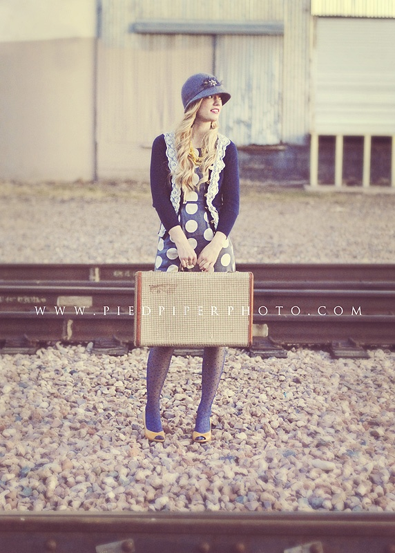 Vintage suitcases make the perfect prop for engagement photos or for senior pictures if the student will be leaving town for college in the fall.