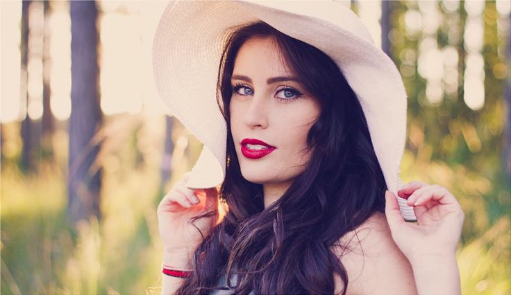 MODEL: Kate Tuttle. IG @ Misskatetuttle Image by Sarah Barlett from Sarah's Photography. White Hat. Pine Forrest. Red Lips, Brunette, Lovely. Head shot.