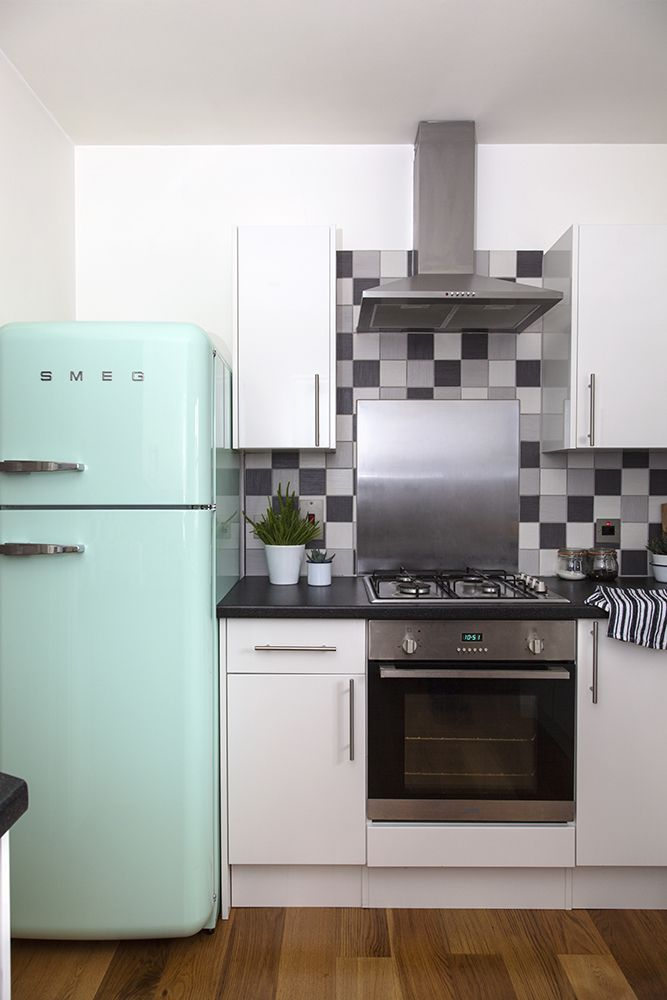 White and grey kitchen with a mint Smeg fridge / Candy Pop