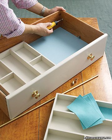 """From Martha 9/07: Cafe-curtain rods mounted inside this drawer provide a track for a tray to slide along, doubling the storage space.  Place one tray (utensil trays are good) about 1"""" above the top of the other.  Tension mounted rods might be good if you don't want to commit."""