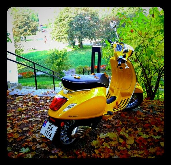 Vespa in autumn leaves in Oslo